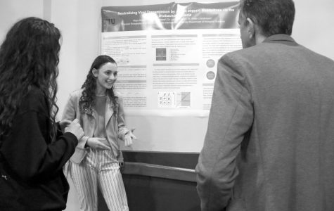 Maya Rosen '21 speaks to guests at the internship forum about her work studying viral transmission among mosquitoes.