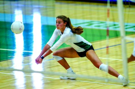 Ellie Carrera-Justiz '19, who will be playing volleyball for Lafayette in the fall, lunges for the ball in an early-season game.