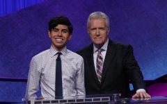 Lucas Miner '21 posing with legendary Jeopardy! host Alex Trebek.