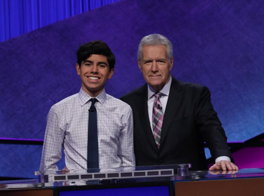 Lucas Miner '21 posing with legendary Jeopardy! host Alex Trebek.
