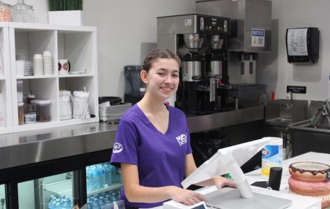 Sophie Leibowitz '20 behind the counter at Mojo Donuts.