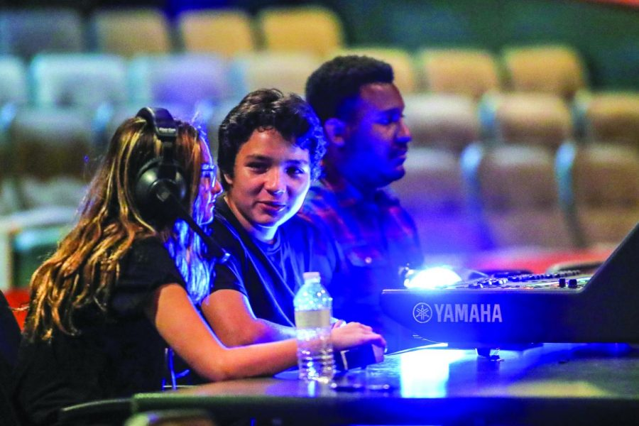 Shelby Sanders '21, Felipe Clavijo '21, and Mr. Quincy Knowles work the sound board during the fall musical production.