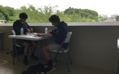 Socially-distanced seniors eating lunch outside