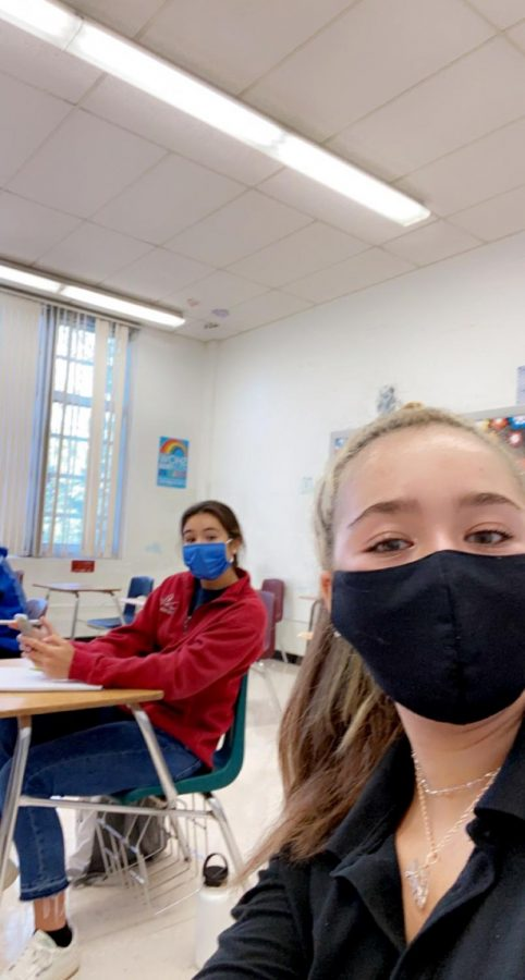 Irene Martinez '21 poses with her mask in her IB English Literature class. The course is one of Irene's three