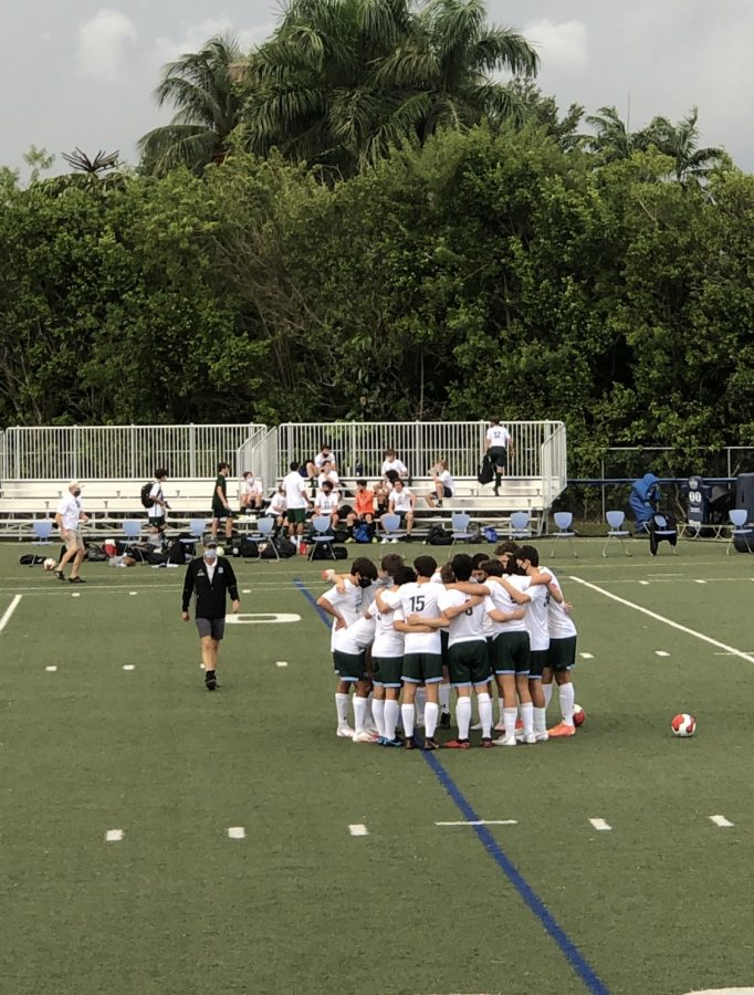 The+varsity+boys%27+soccer+team+huddling+before+Friday%27s+game.