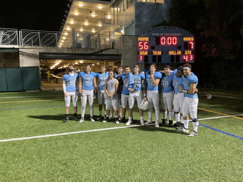 Raiders gather to take one last photo celebrating the 2020 season.