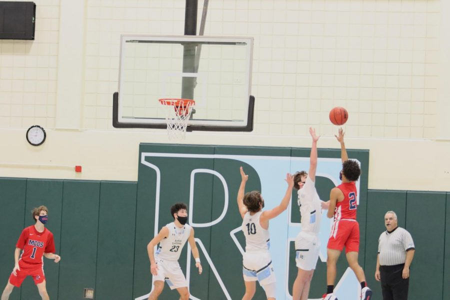 Zach Marcus '22 and Neil Schiff '21 attempt to block a MCDS shot