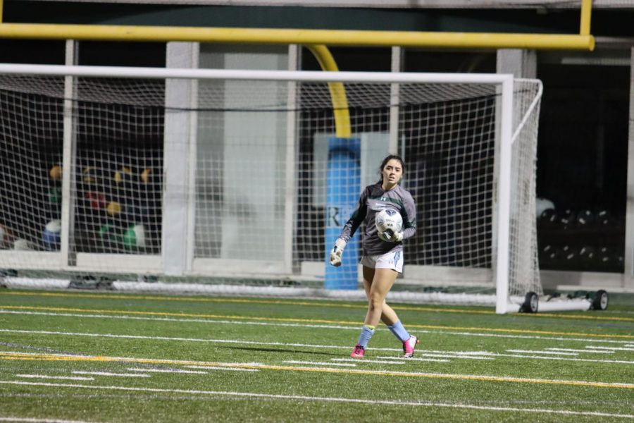 Dani Ortiz '21 looks to set up a clear following a saved goal