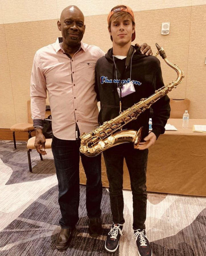 Munroe standing with Ron McCurdy, a Professor of Music at the University of South Carolina