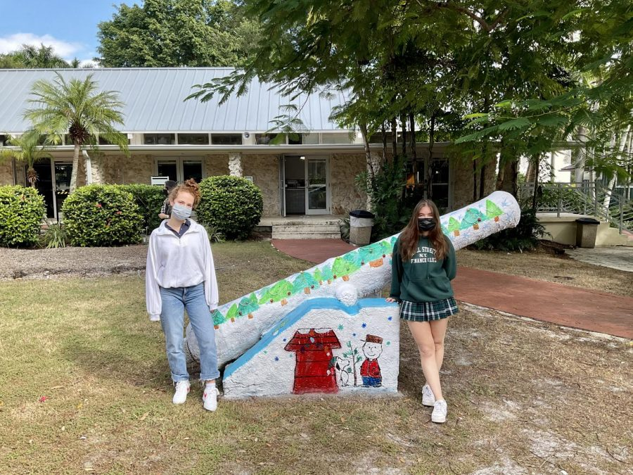 Rachel Bienstock '21 and Claire Holzman '21 standing beside the cannon painted to celebrate this year's virtual St. Albans Day.