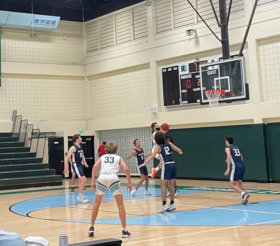 Nick Lampert '21 drives for a layup early in the second quarter.