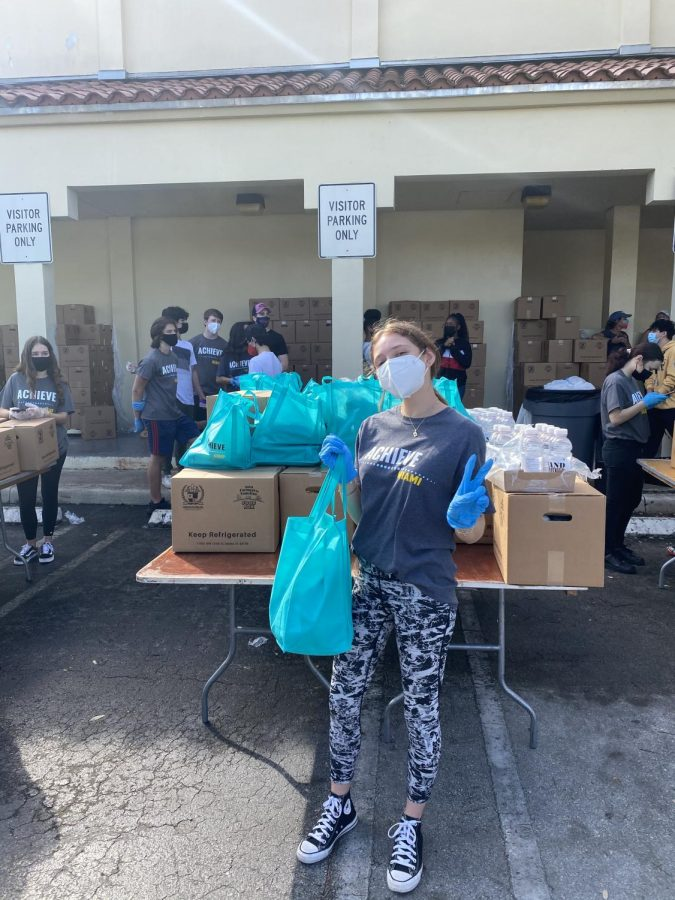Ava Levinson '21 works a food drive for Achieve Miami at Booker T. Washington high school.