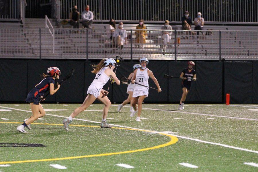 Ellie Dyke '21 leads a fast-break late in the first half.