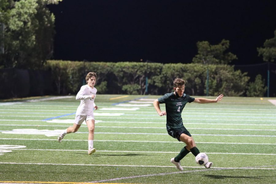 Rylan Sadler '22 attacking the controlling a pass and making a quick attack in the second half.
