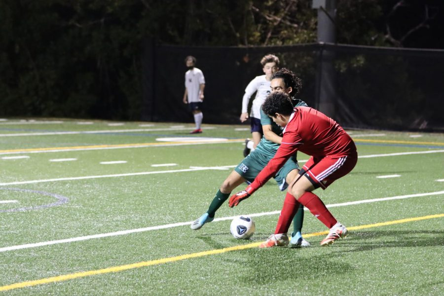 Danny Mendoza '21 battles for possession in the first half.