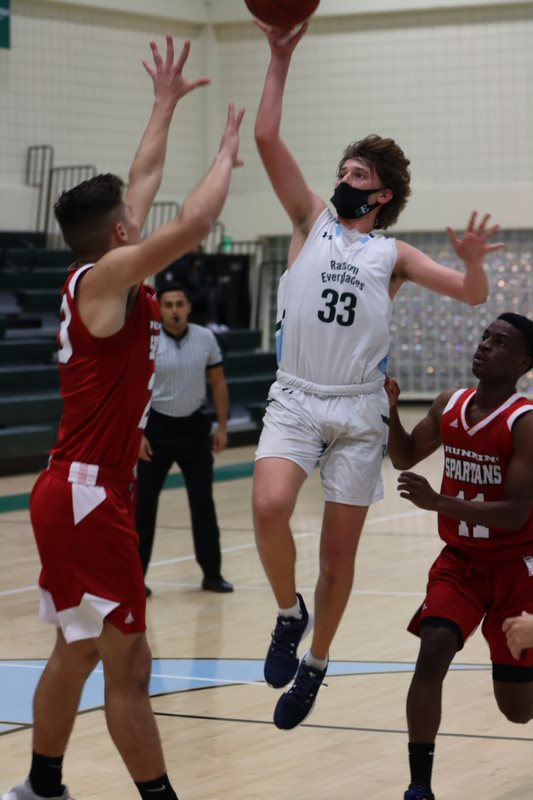 Asher Zhuk '23 drives to the basket.