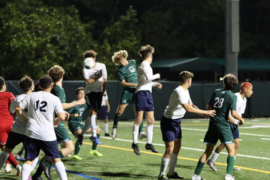 Daniel Stancioff '23 headers in RE's fourth goal of the game.