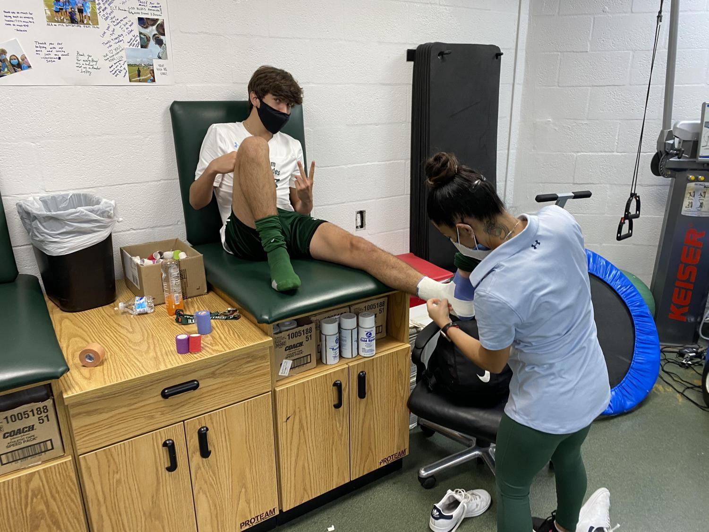 Ms. Zamani treats an RE athlete.