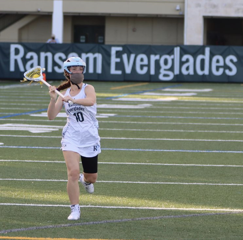 Rachel Bienstock '21 gets ready to pass the ball as she runs up the field