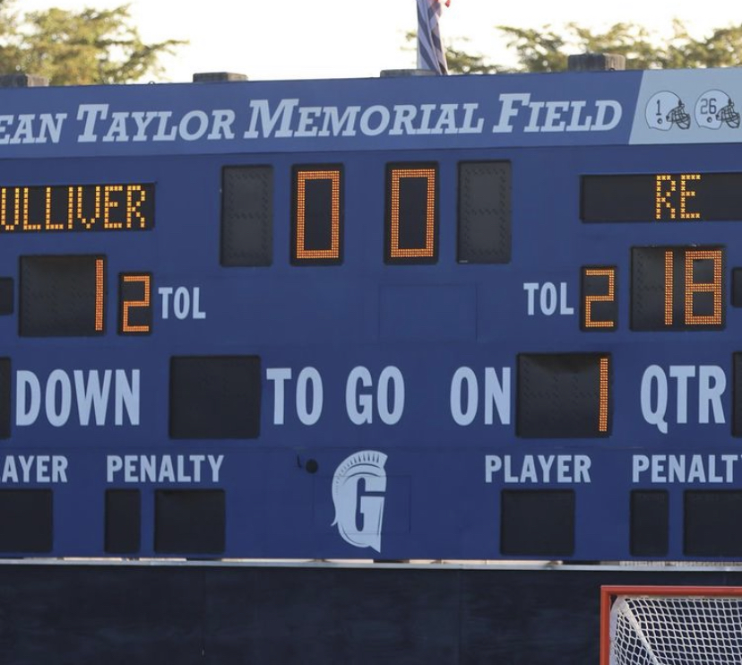 Gulliver scoreboard displays final score of the game at Sean Taylor Memorial Field.