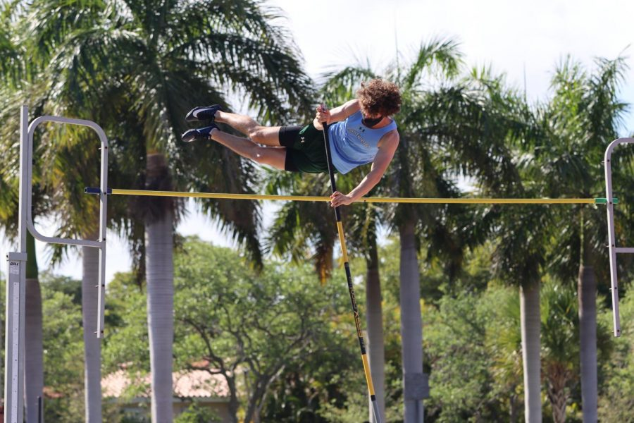 Aidan Rothestein 22 goes for first place in the pole vault competition.