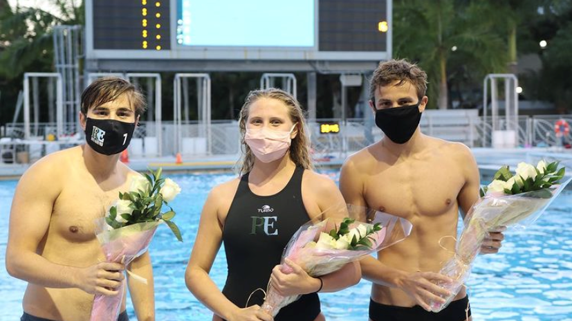 Camille Devaney '21, Lucas Gomez '21 and Hayes Holly '21 are honored on senior night.