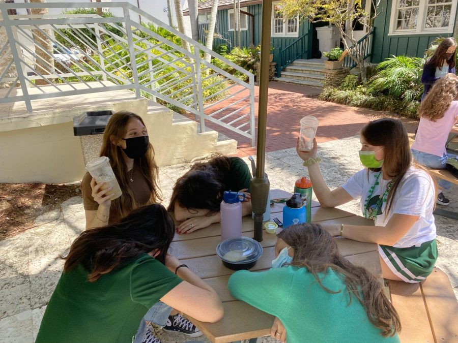 After running over to Starbucks, seniors Claire Holzman '21 and Ava Levinson '21 are re-energized, while their caffeine-deprived peers sleep in the quad.