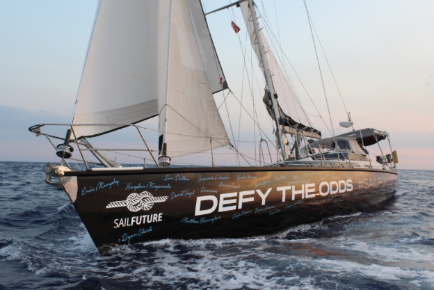 SV Defy the Odds, SailFuture's 65-foot sailboat, soaring through the ocean on its way from Turkey.