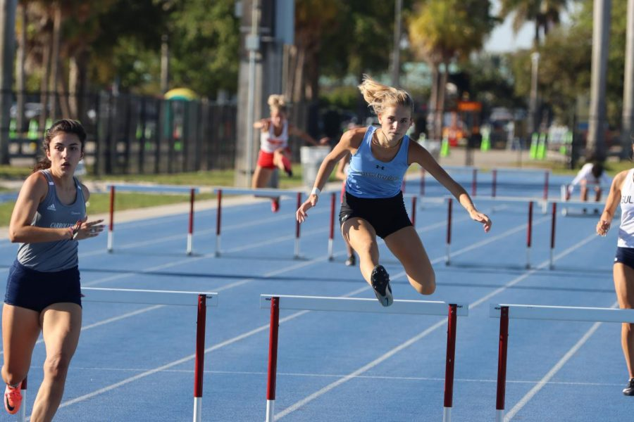 Nicole Tacher '21 runs in the 300-meter hurdles competition.