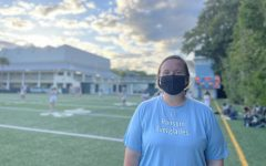 Coach Kisthardt smiles behind her mask as the RE Girls Lacrosse Team secures another win