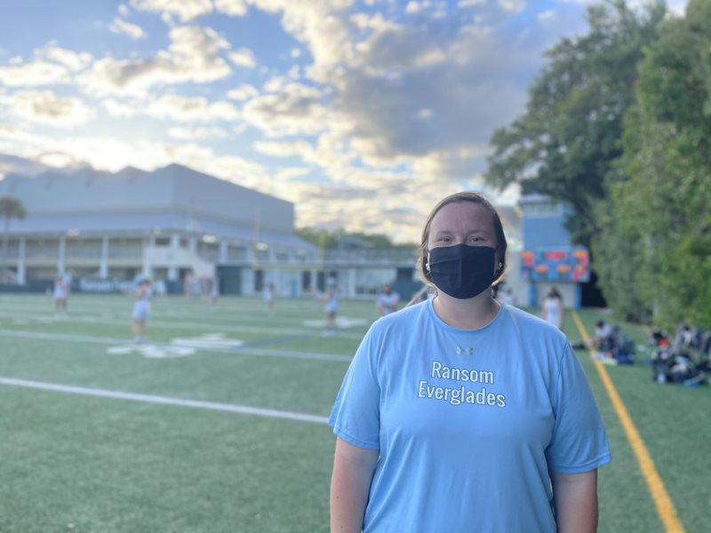 Coach+Kisthardt+smiles+behind+her+mask+as+the+RE+Girls+Lacrosse+Team+secures+another+win