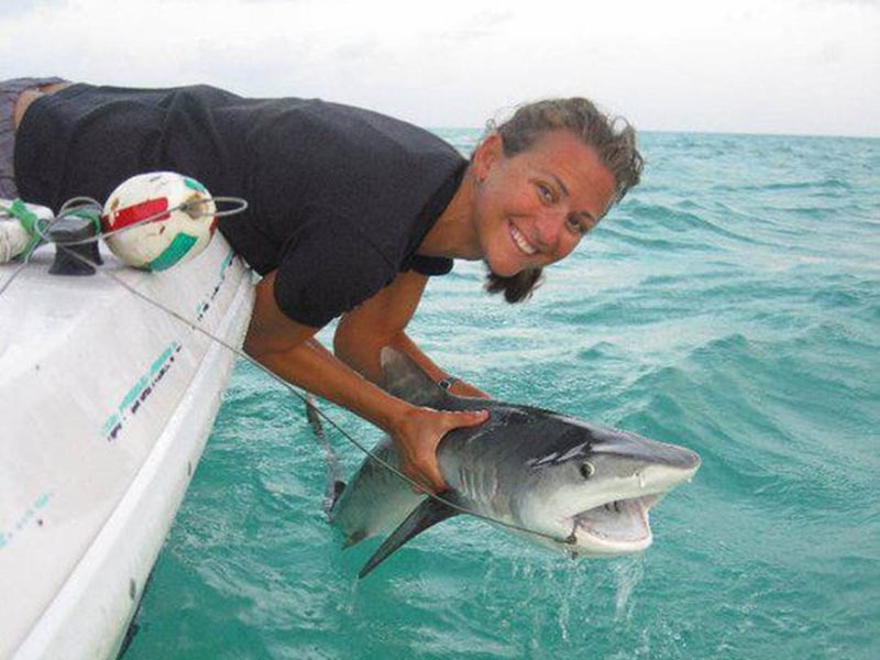 Dr. Stump is pictured in her element: out on the water researching sharks