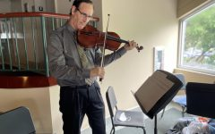 Mr. O'Donnell practicing the viola in the Lewis Family Auditorium.